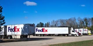 BEMIDJI, MN - 26 APR 2019: Fleet of FedEx delivery trucks at local facility. BEMIDJI, MN - 26 APR 2019: A fleet of large FedEx delivery trucks parked at a stock photos