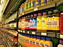 BEMIDJI, MN - 8 FEB 2019: Rows of bottled beverages stacked on shelves stock image