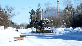 Bemidji, MN - 24 Feb 2019: Snowplow clearing snow on street. Bemidji, MN - 24 Feb 2019: Snowplow clearing snow on street after winter storm stock footage