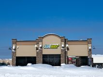 BEMIDJI, MN - 8 FEB 2018: Subway restaurant and in winter with snow and blue sky royalty free stock photography