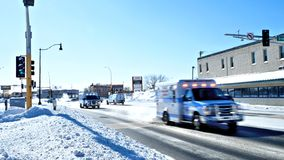 BEMIDJI, MN - 8 FEB 2019: Two Ambulances rush to an emergency royalty free stock photography