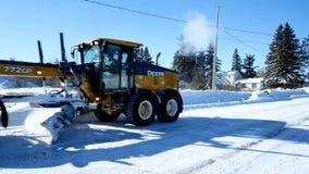 Bemidji, Mn - 8 Feb 2019: Yellow snowplow clears snow from streets in winter. Bemidji, Mn - 8 Feb 2019: Yellow snowplow clears snow from streets on cold sunny stock video