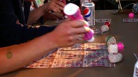 BEMIDJI, MN - 5 JUL 2019: Playing bingo with several cards at the same time.