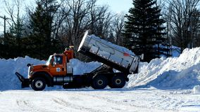 BEMIDJI, MN - 6 MAR 2019: Dump truck empties box of snow that has been cleared from city streets. After multiple storms stock video