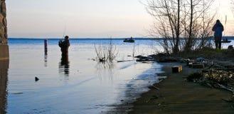 Fishermen fishing in Lake Bemidji during opener. Silhouette of Fishermen fishing in Lake Bemidji near bridge over the Mississippi River during the Minnesota royalty free stock photos