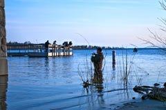 BEMIDJI, MN - 11 MAY 2019: Fishermen fishing in Lake Bemidji during opener. BEMIDJI, MN - 11 MAY 2019: Fishermen fishing in Lake Bemidji near bridge over the royalty free stock photography