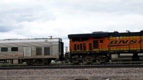 BEMIDJI, MN - 5 MAY 2019: Locomotive train engine and two older gray cars.