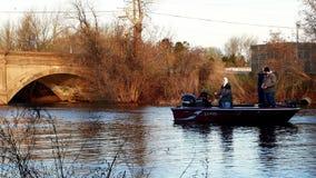 BEMIDJI, MN - 11 MAY 2019: Men in motor boat on Mississippi River on morning of Minnesota Fishing Opener.