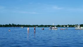 Bemidji, MN USA - June, 2018: People families arrive by boat to enjoy fun time on sandbar