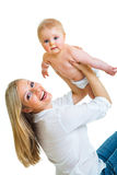 Bemuttern Sie Holdingnettes Säuglingsmädchen lizenzfreies stockbild