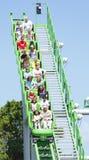 Ben 10 Roller coaster. Children enjoy roller coaster ride at family theme park / funfair Drayton Manor Park, England.  New Ben 10 roller coaster ride Stock Photo