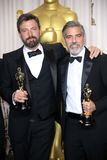 Ben Affleck,George Clooney. Ben Affleck and George Clooney  at the 85th Annual Academy Awards Press Room, Dolby Theater, Hollywood, CA 02-24-13 Stock Photography