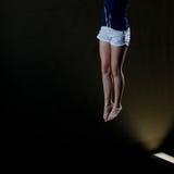 Ben av gymnasten Arkivbild