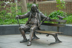 Ben on The Bench. A statue of Benjamin Franklin sitting on a bench at the University Of Pennsylvania stock image