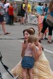 Princess Belle hugs little girl  Des Moines, Iowa, August 8, 2015 Stock Image