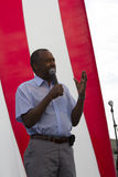 Ben Carson speaks in front of a US flag, August 2015 Stock Image