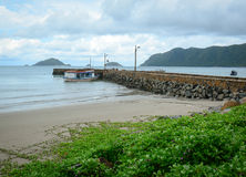 Ben Dam jetty at rainy day in Con Dao, Vietnam Royalty Free Stock Images