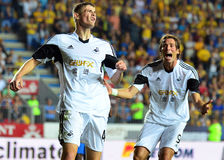 Ben Davies and Michu in Petrolul Ploiesti-Swansea FC Royalty Free Stock Photo