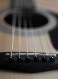 Ben för gitarrdetaljbro Royaltyfri Bild