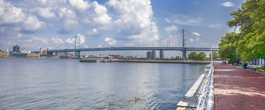 Ben Franklin Bridge. View of the Ben Franklin bridge from Ulysses Wiggins Waterfront park in Camden, NJ is a major toll road connector between Philadelphia and Royalty Free Stock Image
