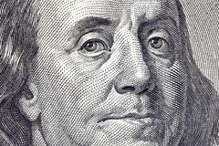Ben Franklin Macro Close Up $100 Bill. Macro close up of Ben Franklin's face on the US $100 dollar bill Royalty Free Stock Photography