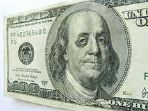 Ben Franklin mit blauem Auge auf hundert Dollarschein. Stockbild