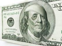 Ben Franklin Wearing Bandages ed aiuto di banda con l'occhio nero su cento banconote in dollari Fotografie Stock