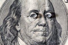 Ben Franklin y x27; cara de s con descensos del agua en ojos en el viejo billete de dólar de los E.E.U.U. $100 Imágenes de archivo libres de regalías