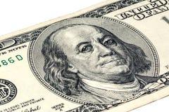 Ben Franklin y x27; cara de s con descensos del agua en ojos en el viejo billete de dólar de los E.E.U.U. $100 Foto de archivo libre de regalías
