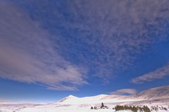 Ben Klibreck snowy landscape. On the road between Lairg and Althnahara in the Highlands of Scotland Royalty Free Stock Photo