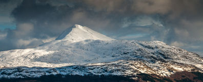 Ben Lomond on a stormy Winter day. Looking across to Ben Lomond on a stormy Winter day from the summit of The Cobbler Royalty Free Stock Image