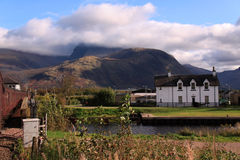 Ben Nevis and the Caledonian Canal, Scotland. Ben Nevis with steam train crossing the Caledonian Canal towards Ben Nevis at Banavie Bridge, on the outskirts of Royalty Free Stock Photos