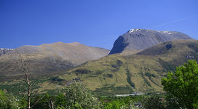 Ben Nevis and Carn Mor Dearg, Scotland, UK. Ben Nevis is the highest mountain in the British Isles - 1,344 metres (4,406 ft) above sea level and is located in Royalty Free Stock Photos