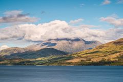 Ben Nevis in the clouds on a Sunny Day Royalty Free Stock Photography