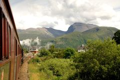 Ben Nevis from the Train. A view of Ben Nevis, the UK's highest mountain taken from a steam train stock image