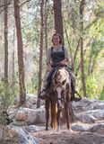 Member of the annual reconstruction of the life of the Vikings - `Viking Village` poses on horseback in the forest near Ben Shemen. Ben Shemen, Israel, November Stock Image