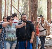 Member of the annual reconstruction of the life of the Vikings - `Viking Village` teaches visitor how to shoot arrows in the fores. Ben Shemen, Israel, November Stock Photos