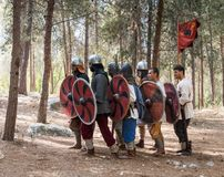 Members of the annual reconstruction of the life of the Vikings - `Viking Village` demonstrate movement on foot in the forest near. Ben Shemen, Israel, November Stock Image