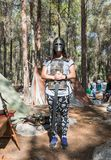 A visitor of the reconstruction `Viking Village` posing in a viking armor in the forest near Ben Shemen in Israel Stock Photo