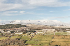Ben Wyvis and the Braes of Strathpeffer in Scotland. Ben Wyvis and the Braes of Strathpeffer from Knockfarrel hill in Scotland Royalty Free Stock Images