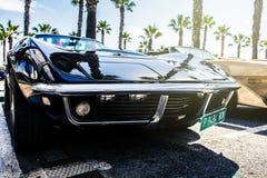 Benalmadena Hiszpania, Czerwiec, - 21, 2015: Czarna Chevrolet korweta C3, frontowy widok, parkujący Benalmadena, Hiszpania, na Cz Fotografia Stock