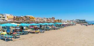 Tourists lying on the Benalmadena beach near Malaga. Benalmadena, Spain, june 29, 2017: Tourists lying on the Benalmadena beach near Malaga Stock Image