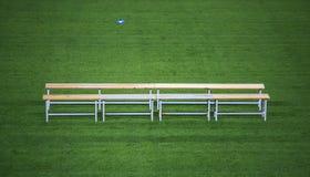 Benc i en fotbollstadion royaltyfria foton