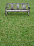 A bench. An empty bench in a London park in the morning light Royalty Free Stock Image