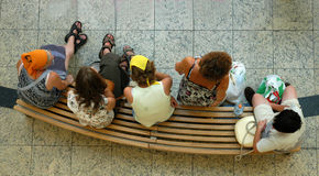 On bench. People in market have a rest on bench stock image
