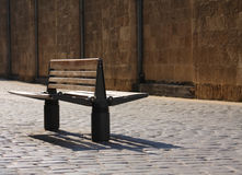 Bench. A bench in a cobblestone paved road Royalty Free Stock Photography