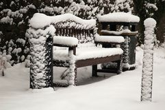 Bench. Covered by snow, horizontally framed shot royalty free stock photos