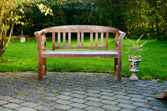 Bench. Beautiful wooden bench in the garden Stock Images