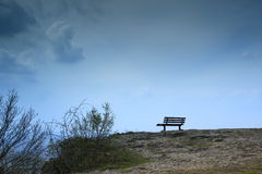 Bench. On a lonely cliff in bad weather Stock Image