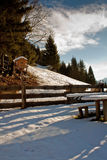 Bench. Frozen bench and winter scenery whit cloud sky Stock Images